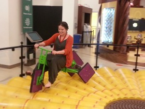 Larissa Raphael, Head of Youth and Family Programs, takes the square-wheeled bike for a test ride.
