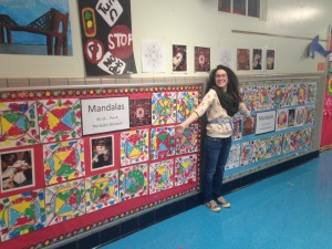 Asya with the Mandalas created by the Pre-K classes!