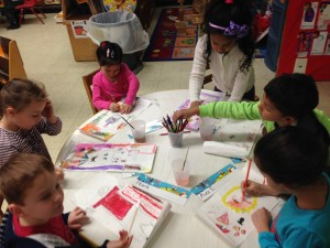 K students working hard on their scrolls!